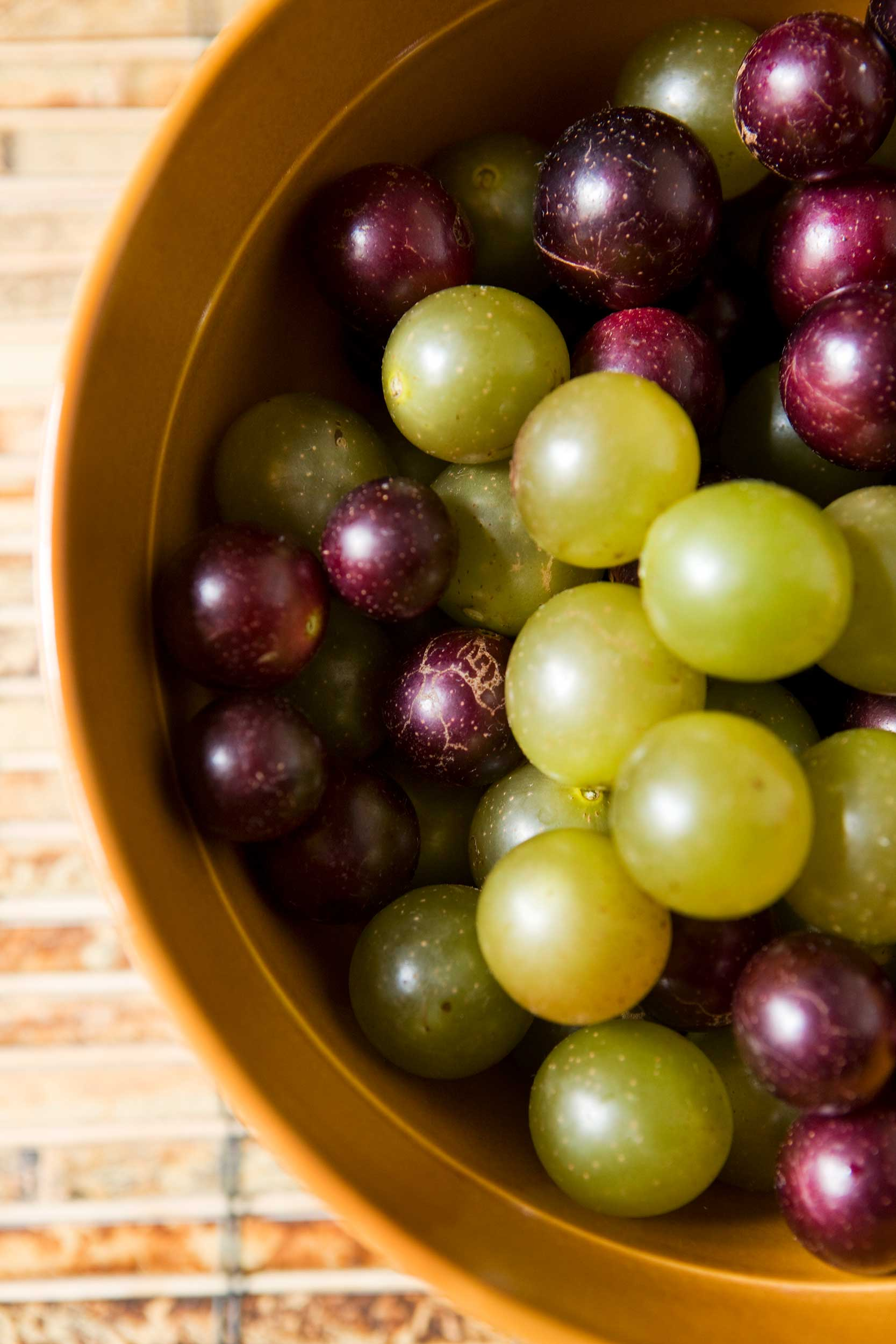 vertical-shot-of-muscadines-and-scuppernongs
