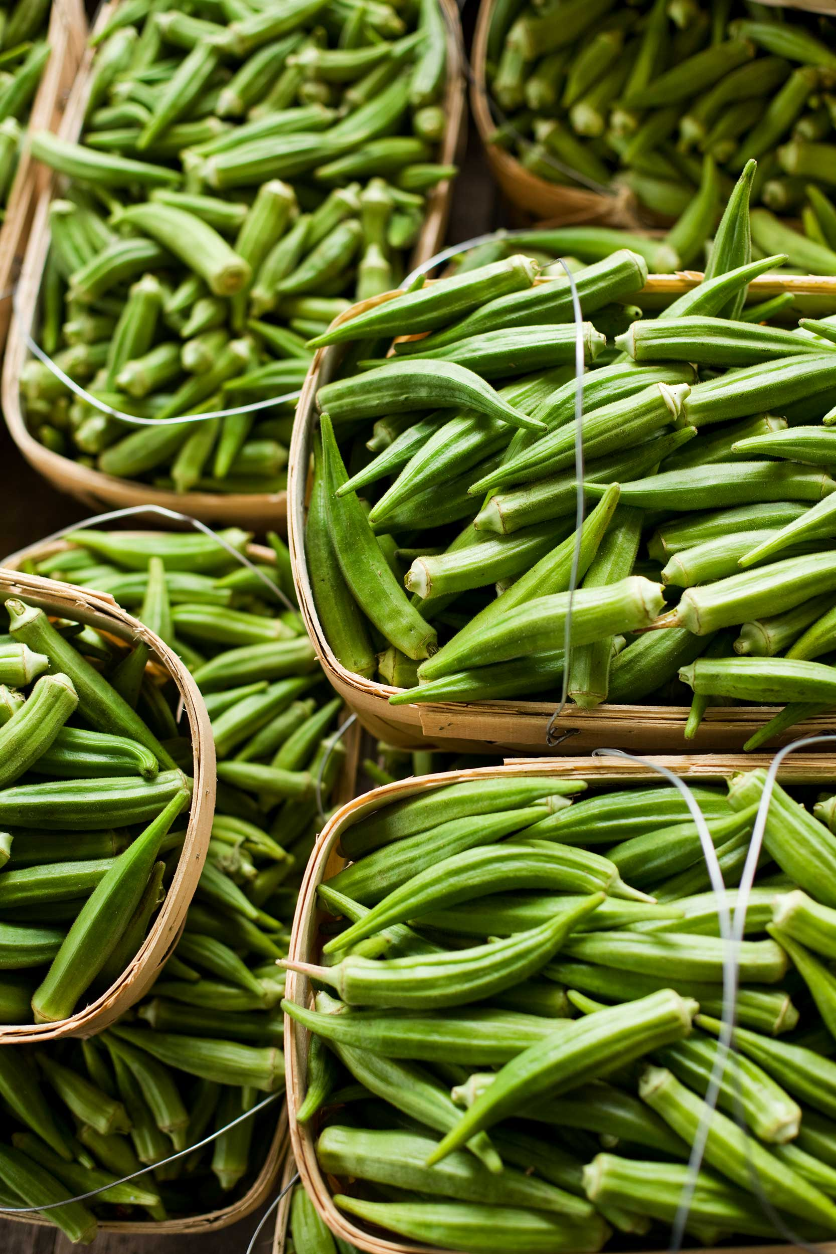 vertical-shot-of-okra-in-baskets